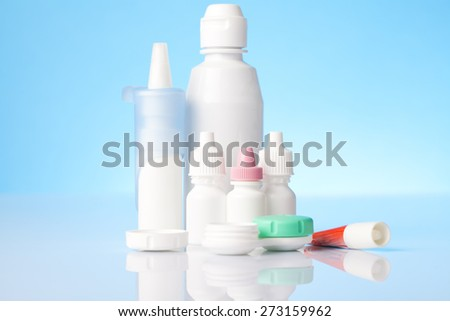 Disinfecting solution for contact lenses and eye and allergy treatment on blue background - stock photo