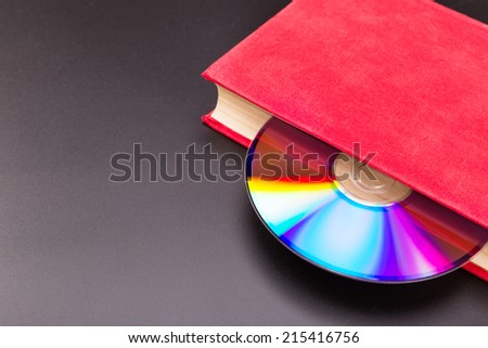 Disk in book - stock photo