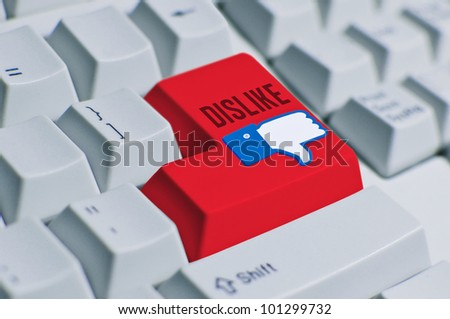 Dislike Button computer keyboard. IT internet and social media network take an important role in life work, social, and relationship. When there is like, there will always be dislike or hate. - stock photo