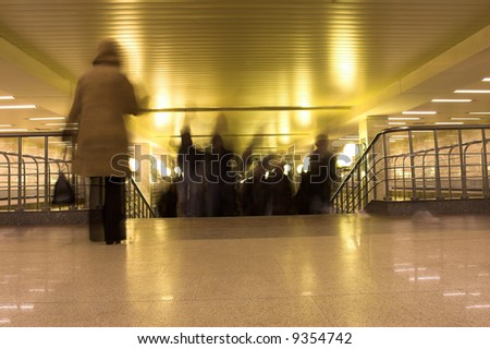 dismount people,stairs, interior in Moscow metro - stock photo