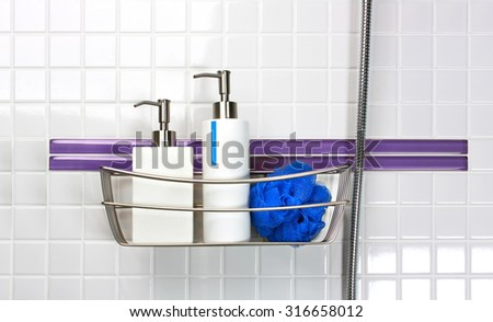 Dispensers of liquid soap and shampoo with bath sponge - stock photo