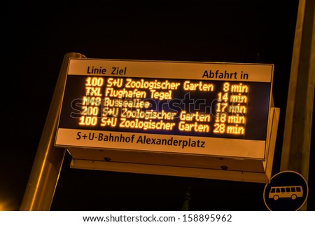 display at busstation in berlin by night