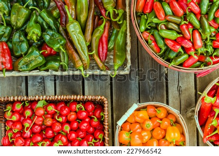 Display of assorted peppers in baskets