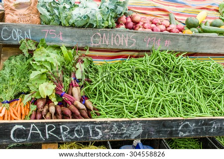 Display of carrots and beets at the farm market - stock photo