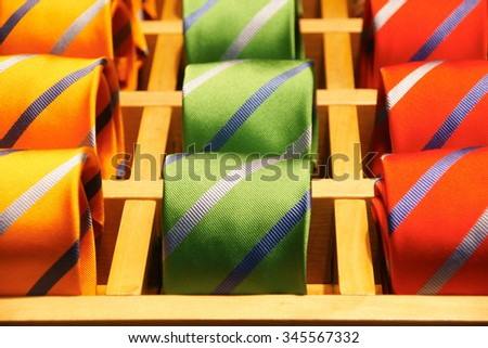 Display of colorful fashionable men ties neckties in a shop showroom  - stock photo