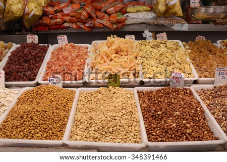 Display of dried fruits and nuts for sale in the indoor market at Valencia, Spain - stock photo