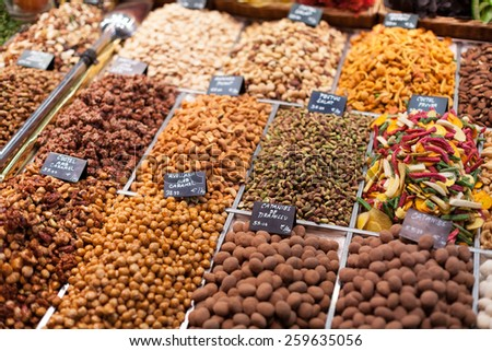 Display of dry fruits for sale at market, La Boqueria Market, Barcelona, Catalonia, Spain