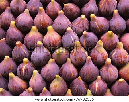 Display of fresh figs at a fruit market. Can be used as a healthy food background. - stock photo