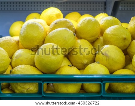Display Of Lemons In Market - stock photo