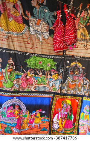 Display of paintings on a cloth at Johari Bazaar in Jaipur, India. Jaipur is the capital and the biggest city of Rajasthan. - stock photo