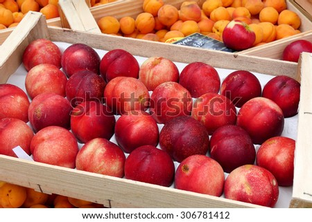 display of peaches and apricots in the French market