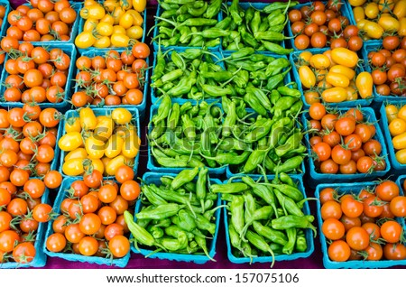 Display of peppers and tomatoes at the farmers market - stock photo