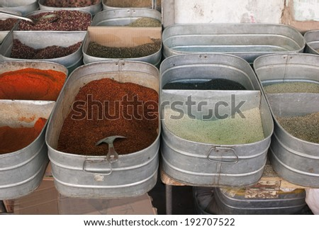 Display of spices for sale at market stall, China - stock photo
