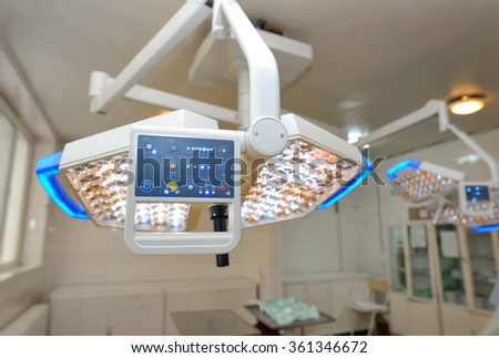 Display of surgical lamps in operation room - stock photo