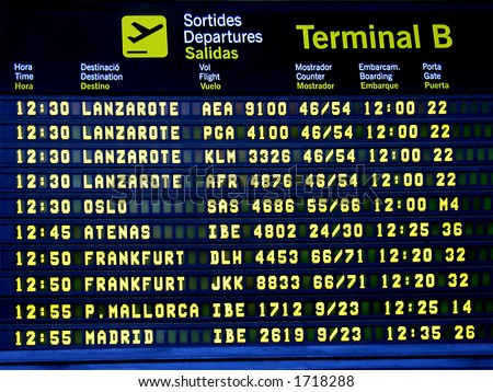 Display panel showing flight arrival time in an airport - stock photo