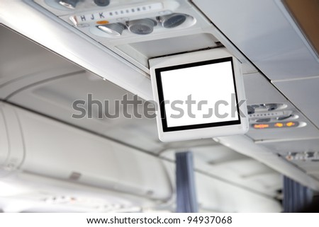 Display screen in the airplane - stock photo
