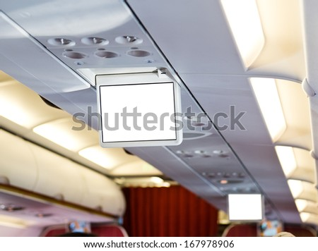 Display screens inside of an aircraft - stock photo