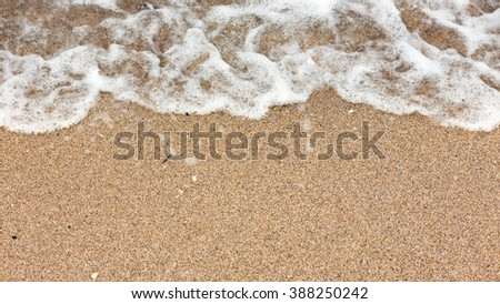 Display texture and color on a sandy beach while photographed in early morning light. Black Sea. Mamaia. Constanta. Romania. soft focus. warm light. old rich colors. - stock photo