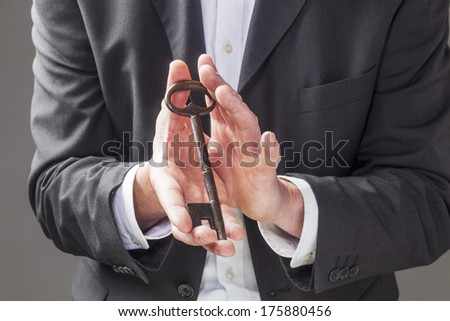 displaying an old key for unlocking a career - stock photo