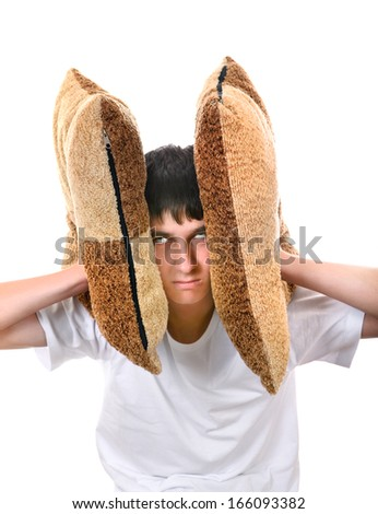 Displeased Teenager covering his Ears with Cushion Isolated On The White Background - stock photo