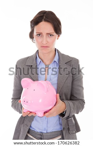 Displeased Young Businesswoman Holding Piggybank Over White Background