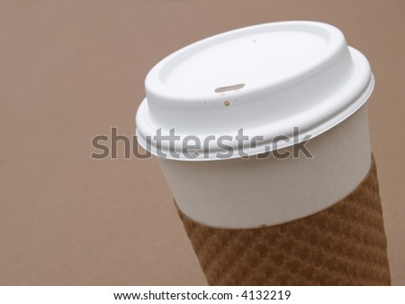 disposable coffee cup with protective cardboard holder - stock photo