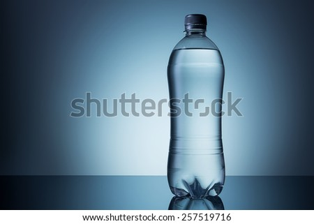 disposable pawn bottle of water - stock photo