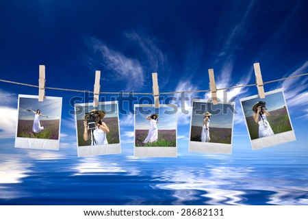 disposable photos frames hanging in the rope on a beautiful summer day - landscape orientation - stock photo
