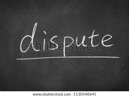 dispute concept word on a blackboard background