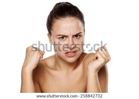 dissatisfied and angry young woman without makeup - stock photo