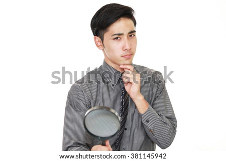 Dissatisfied Asian businessman - stock photo