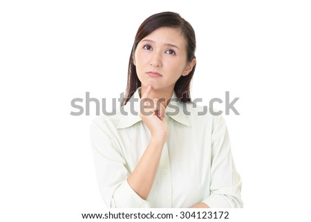 Dissatisfied Asian woman - stock photo