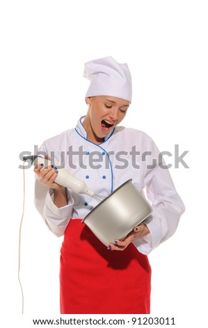 Dissatisfied woman chef  with blender and pot  isolated on white - stock photo