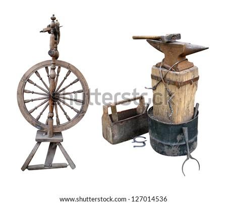 distaff spinning wheel  anvil instruments metalwork - stock photo
