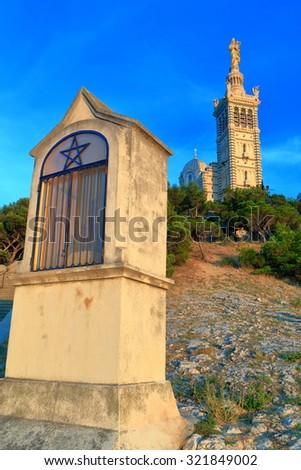 Distant church of Notre Dame de la Garde on a hill at sunset, Marseille, France - stock photo