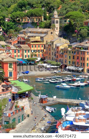 Distant church tower and traditional buildings near the harbor of Portofino, Italy