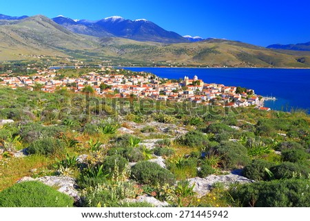 Distant houses of a Greek fishermen town near the Corinthian gulf, Greece - stock photo