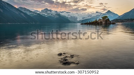 Distant mountains surround Garibaldi lake - stock photo