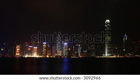 distant shot of hong kong cityscape at night - stock photo