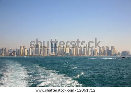 Distant View Dubai Marina Buildings From Gulf - stock photo