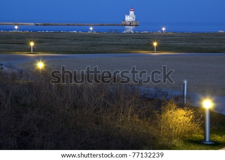 Distant view of Milwaukee Harbor Lighthouse - stock photo