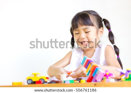 Distemper child playing the toys.