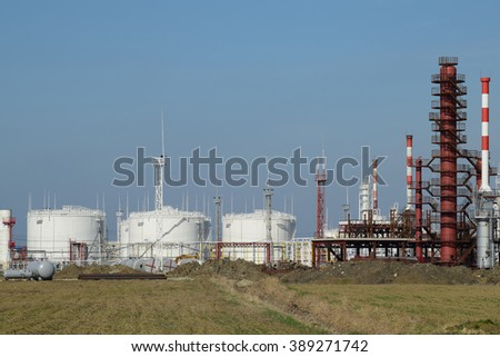 Distillation columns, pipes and other equipment furnaces refinery. The oil refinery. Equipment for primary oil refining.                             - stock photo