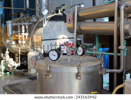 distillation of essential oils in a factory - stock photo