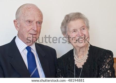 Distinguished old formal couple