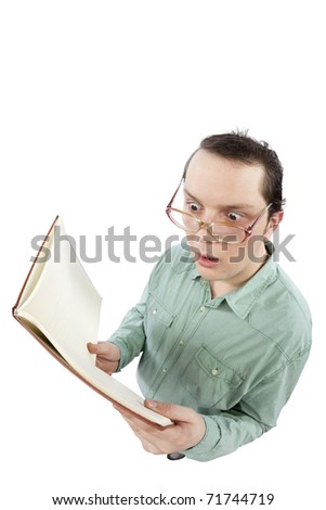 Distorted image of a nerd reading a book and being shocked of what he reads. Fish-eye lens used. Studio shot. Isolated on pure white background. - stock photo