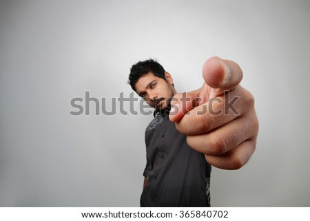 Distorted wide angle view of a man pointing his finger