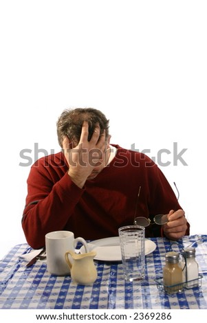 distraught man at table in cafe - stock photo