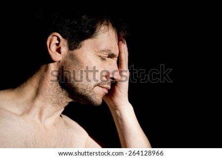 Distraught Man With Head In Hand