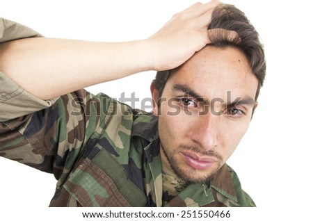 distraught military soldier veteran ptsd with teary eyes isolated on white - stock photo